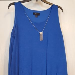 Blue tank top with silver necklace
